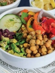 Mediterranean grain bowl on the table with fork