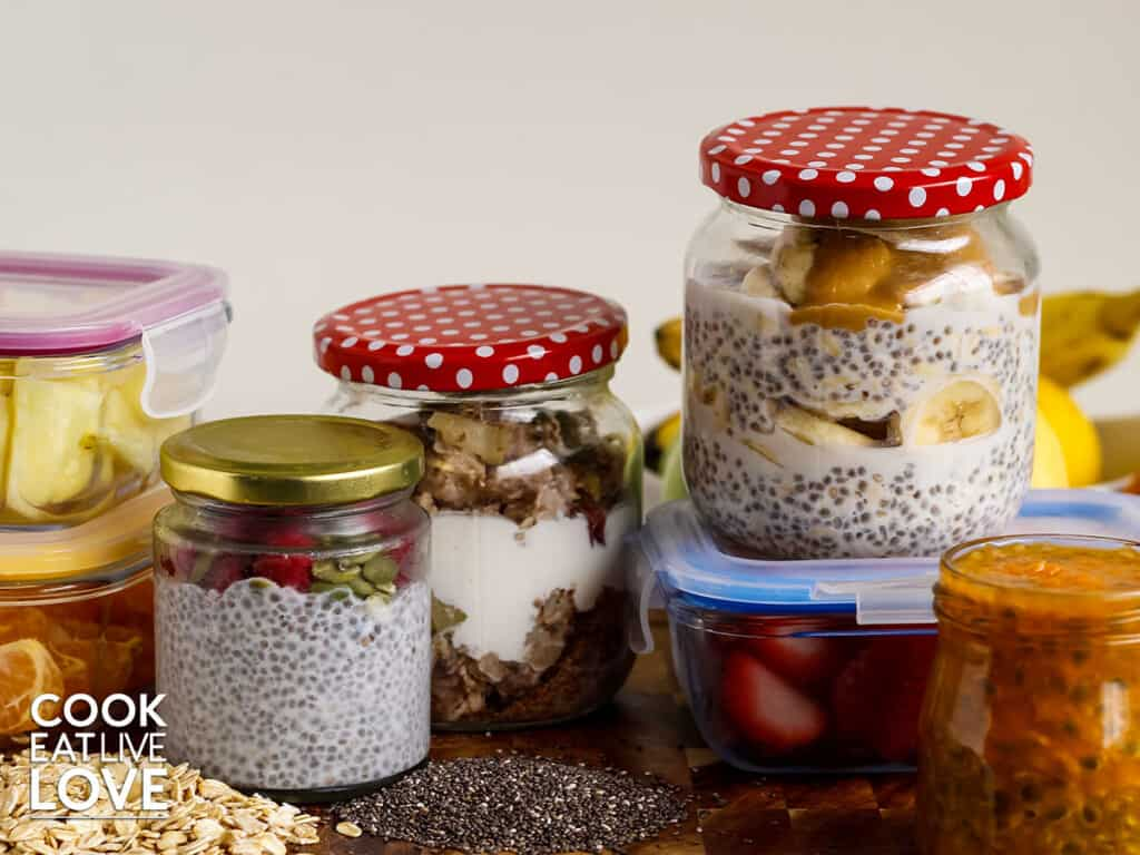 Jars of oats prepped up with fruit on counter