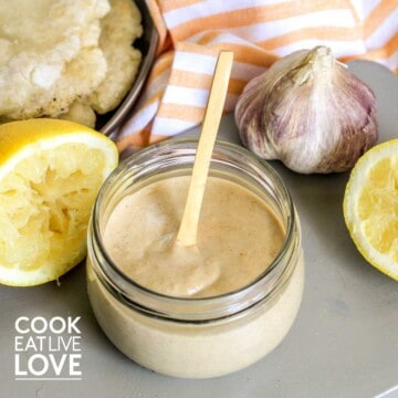 Vegan tahini dressing in jar with spoon