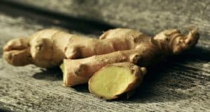 Fresh ginger is a knobby shaped bulb with a thin skin and yellow inside.