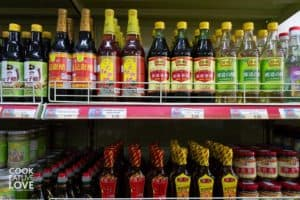 Photo of sauces, oils and flavorings in Chinese grocery store.