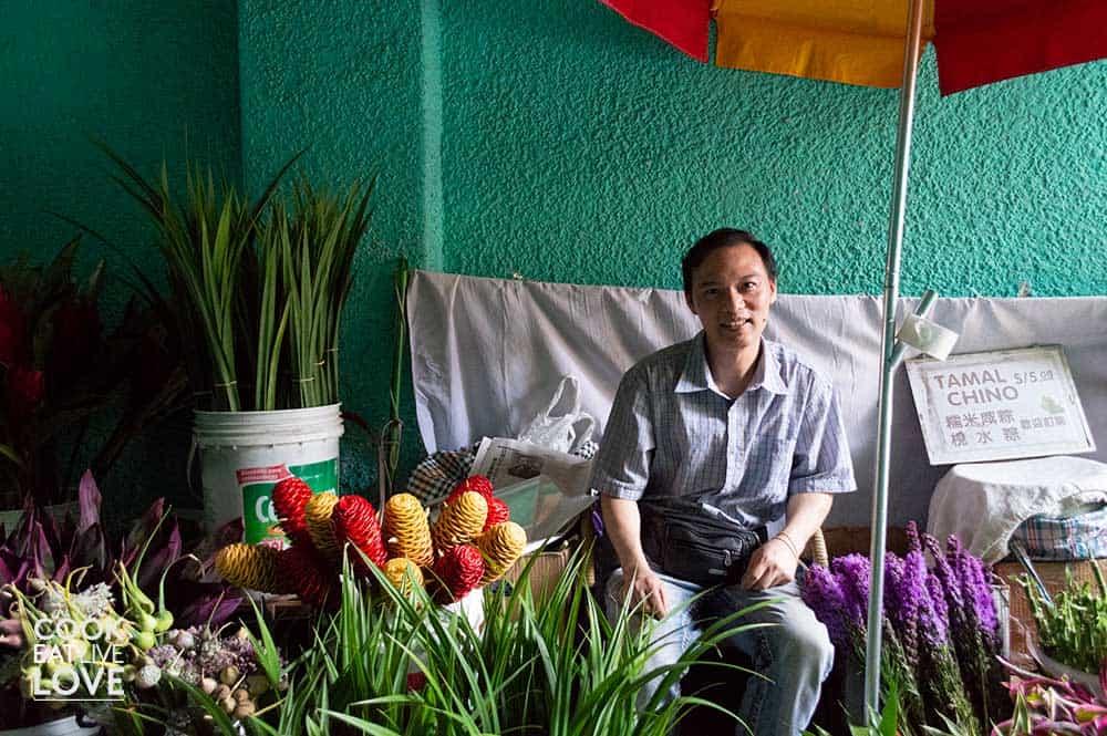 Flower vendor in Barrio Chino set up in alleyway.