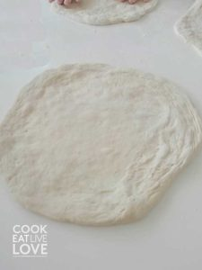 Pizza dough stretched out