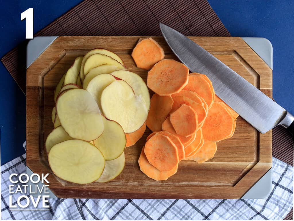 Sliced potatoes and sweet potatoes on a cutting board