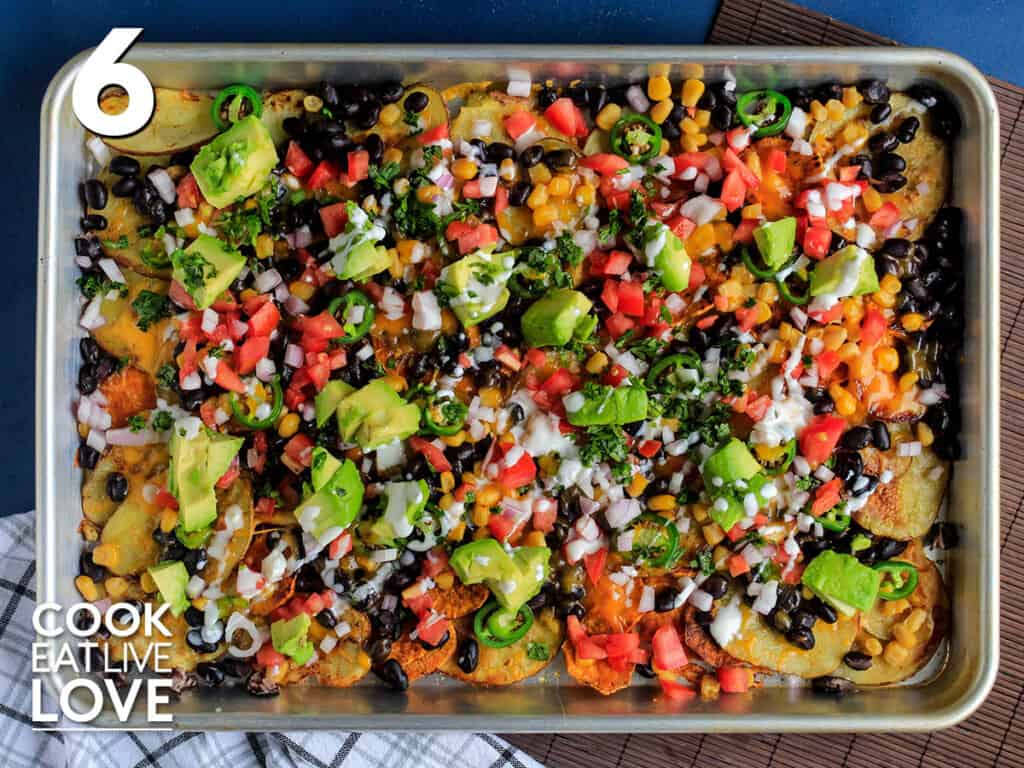 The rest of toppings are added to cooked veggie loaded nachos