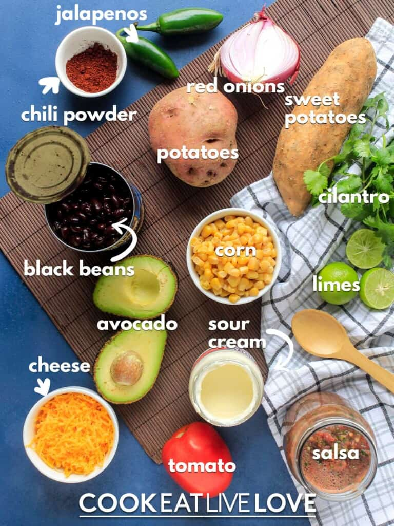 Ingredients to make veggie loaded nachos on the table with text labels