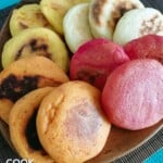 Colored Venezuelan arepas on a plate ready to eat