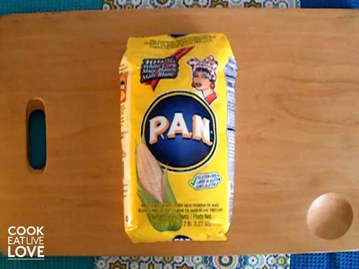 PAN to make arepas on cutting board