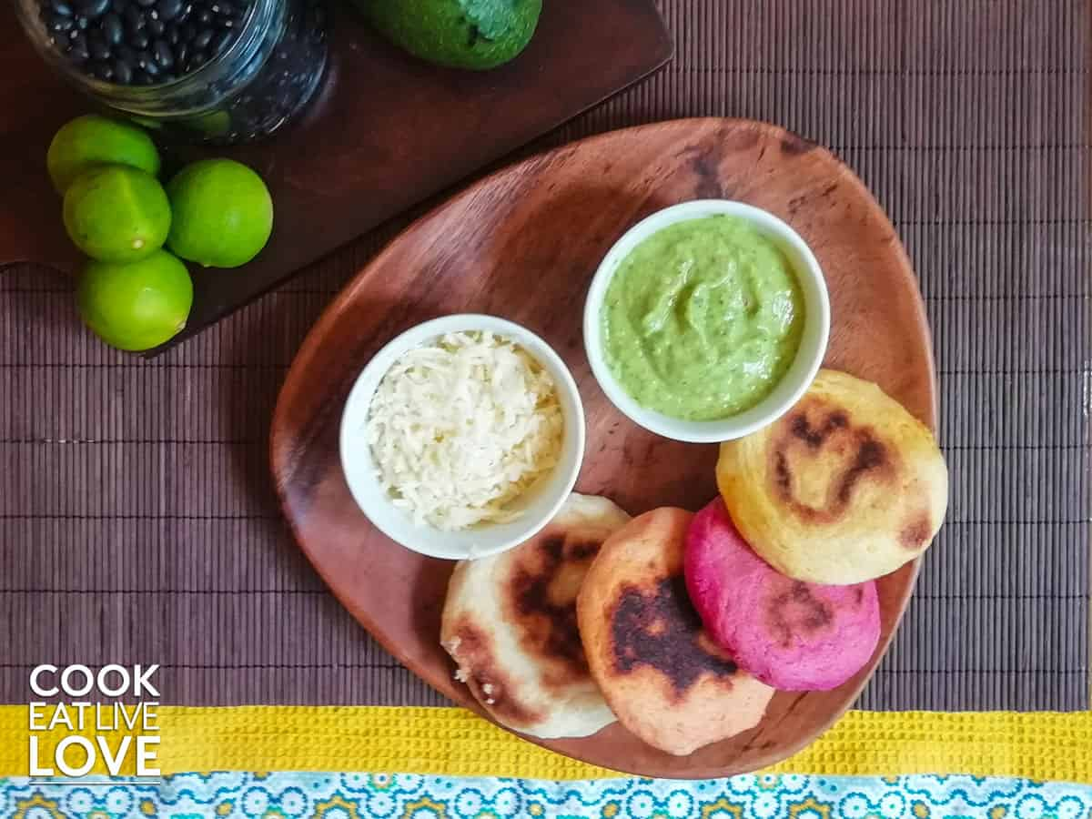 Arepas on plate set on brown placemat