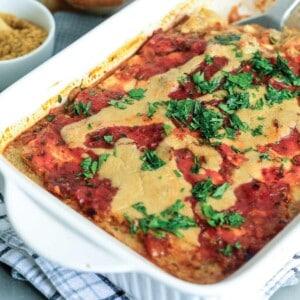 White casserole dish with zucchini lasagna