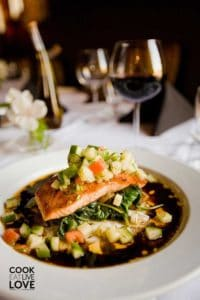 Salmon on a plate with lots of vegetables makes this meal a part of healthy dieting.
