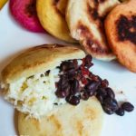 el domino arepa with black beans and shredded white cheese