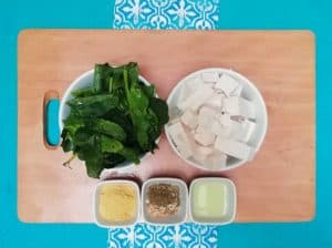 Ingredients for tofu mixture. Spinach, tofu, nutritional yeast, spices, lemon juice