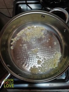 Making Red Wine Mushroom Miso Sauce: Start with garlic in pan