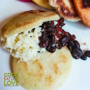 Arepas with beans and cheese on a plate
