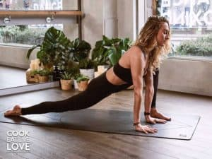 Girl in lunge on yoga mat