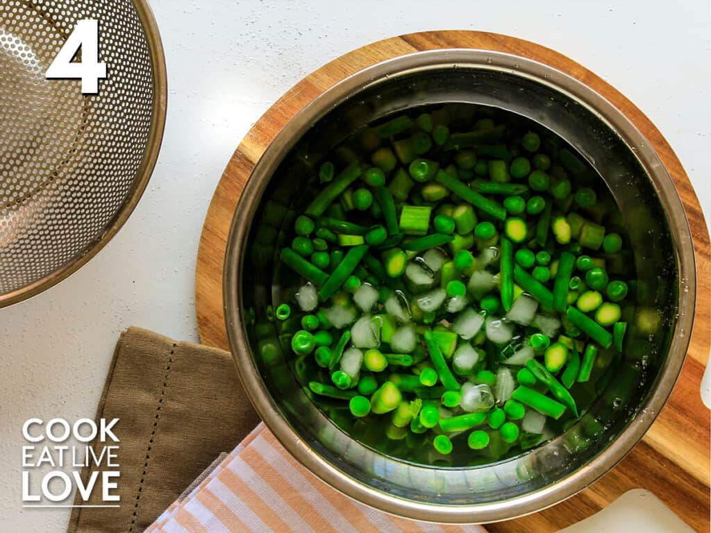 Cooked vegetables in cold water