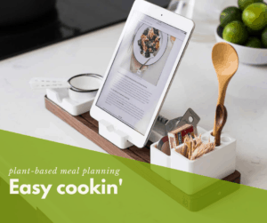 Recipe displayed on ipad in kitchen with cooking utensils.