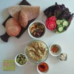 Chickpea salad with different flavors, breads and veggie toppings