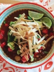 Bowl of soup topped with tortilla strips