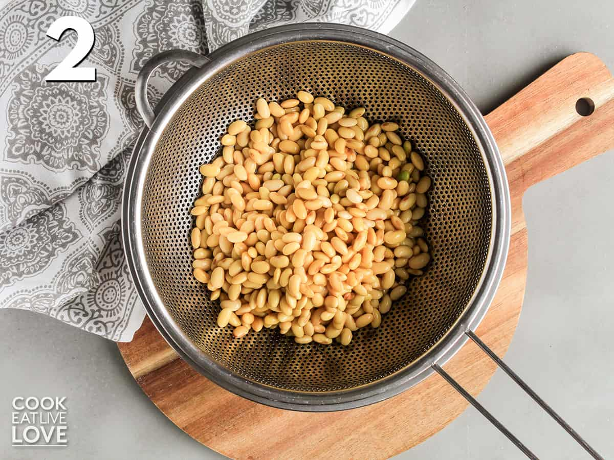 Soaked soybeans in a strainer