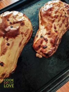 Whole roasted butternut squash on pan