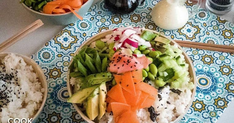Overhead shot of sushi rice bowl showing all the vegetables, sauces and garnishes.