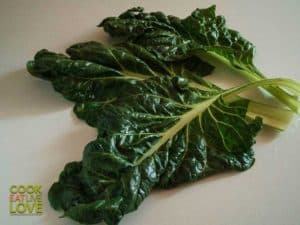 Whole swiss chard leaves on white background