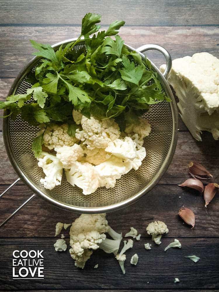 Cauliflower and parsley in steamer basket