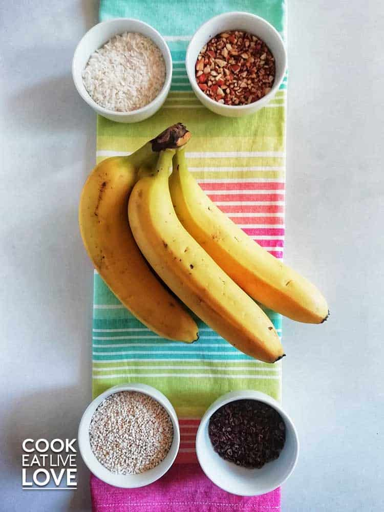 Coconut, nuts, amaranth and cacao nibs are perfect toppings for these frozen chocolate bananas.