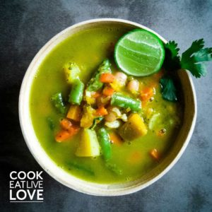 Green soup with vegetables and lime squeeze