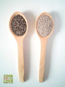 White and gray chia is pictured here in wooden spoons.