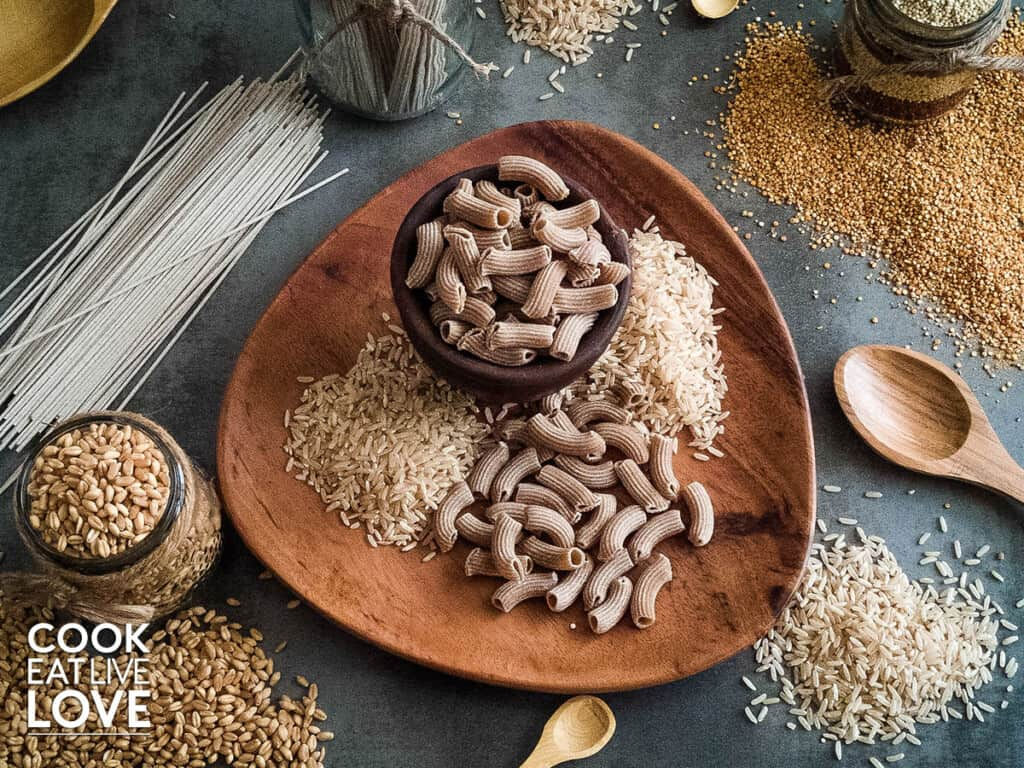 Assorted whole grains are shown in this photo including brown rice, wheatberries, quinoa and soba noodles