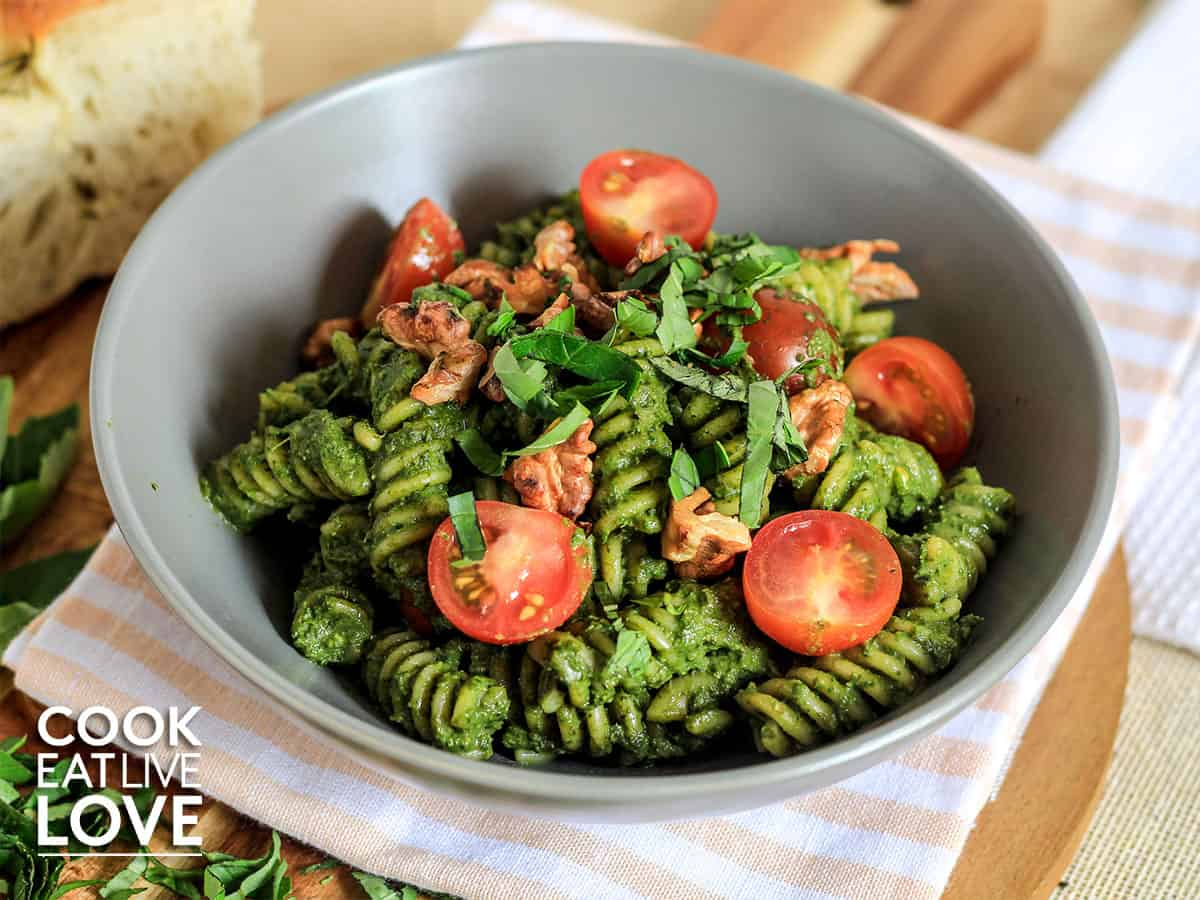 Bowl of spinach pesto pasta on table