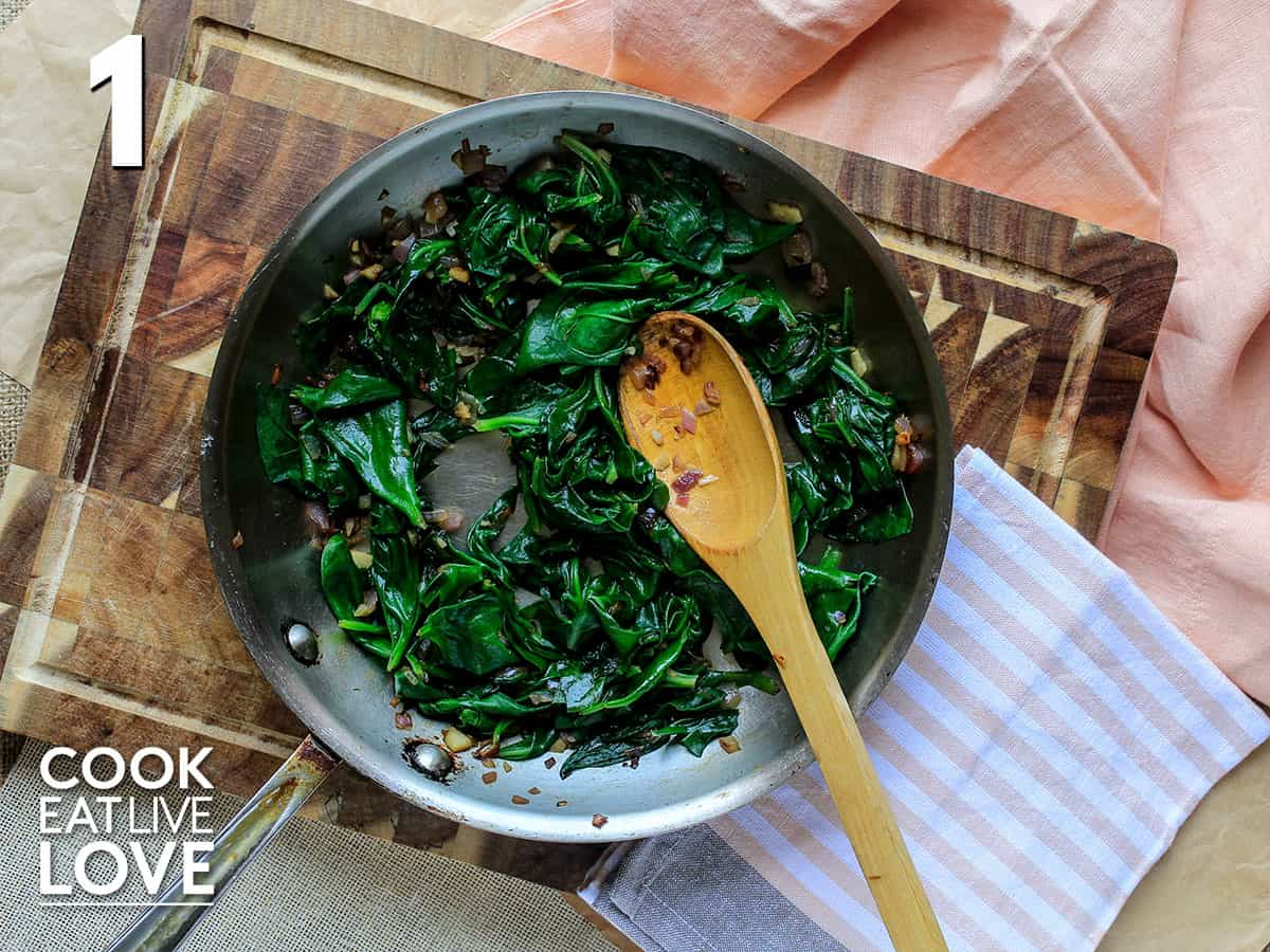 Spinach cooking in a skillet