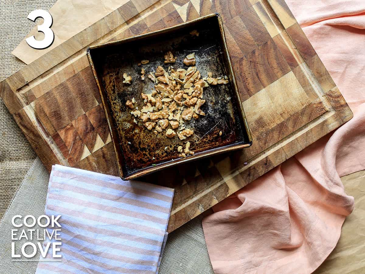 Walnuts in small rectangle pan for the oven.