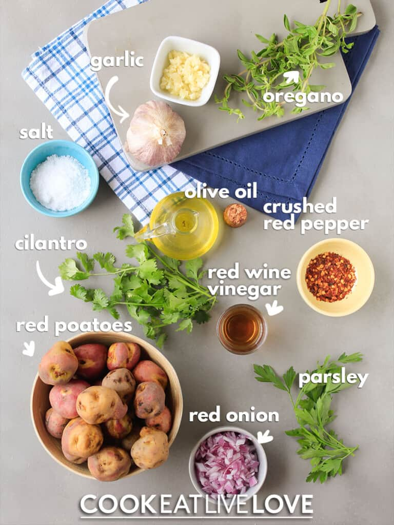 Ingredients to make this smashed potatoes recipe on a table with text labels.