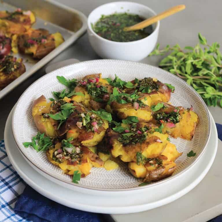 Chimichurri potatoes are shown on white plate...ready to eat.