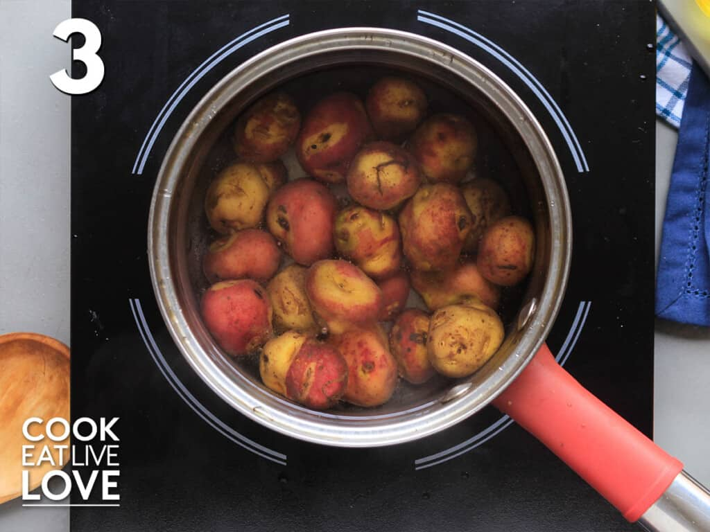 Potatoes cooking in a pot of water