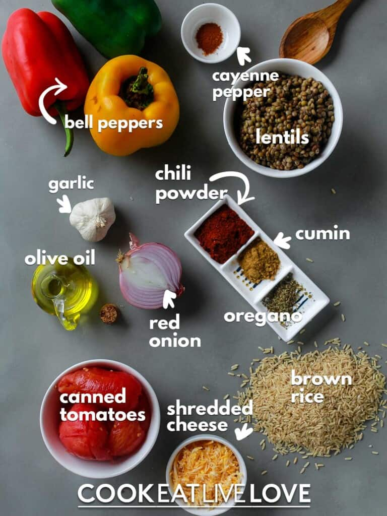 Ingredients to make lentil stuffed peppers on the table with text labels