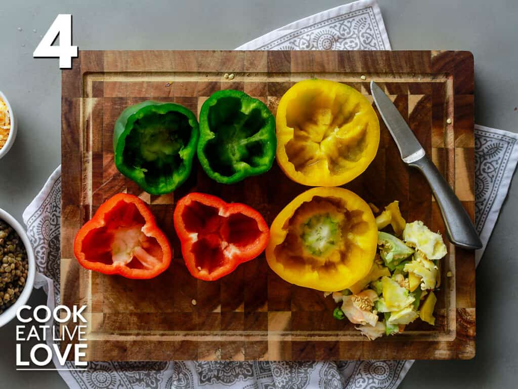 Peppers cut in half before stuffing with lentil and rice mixture