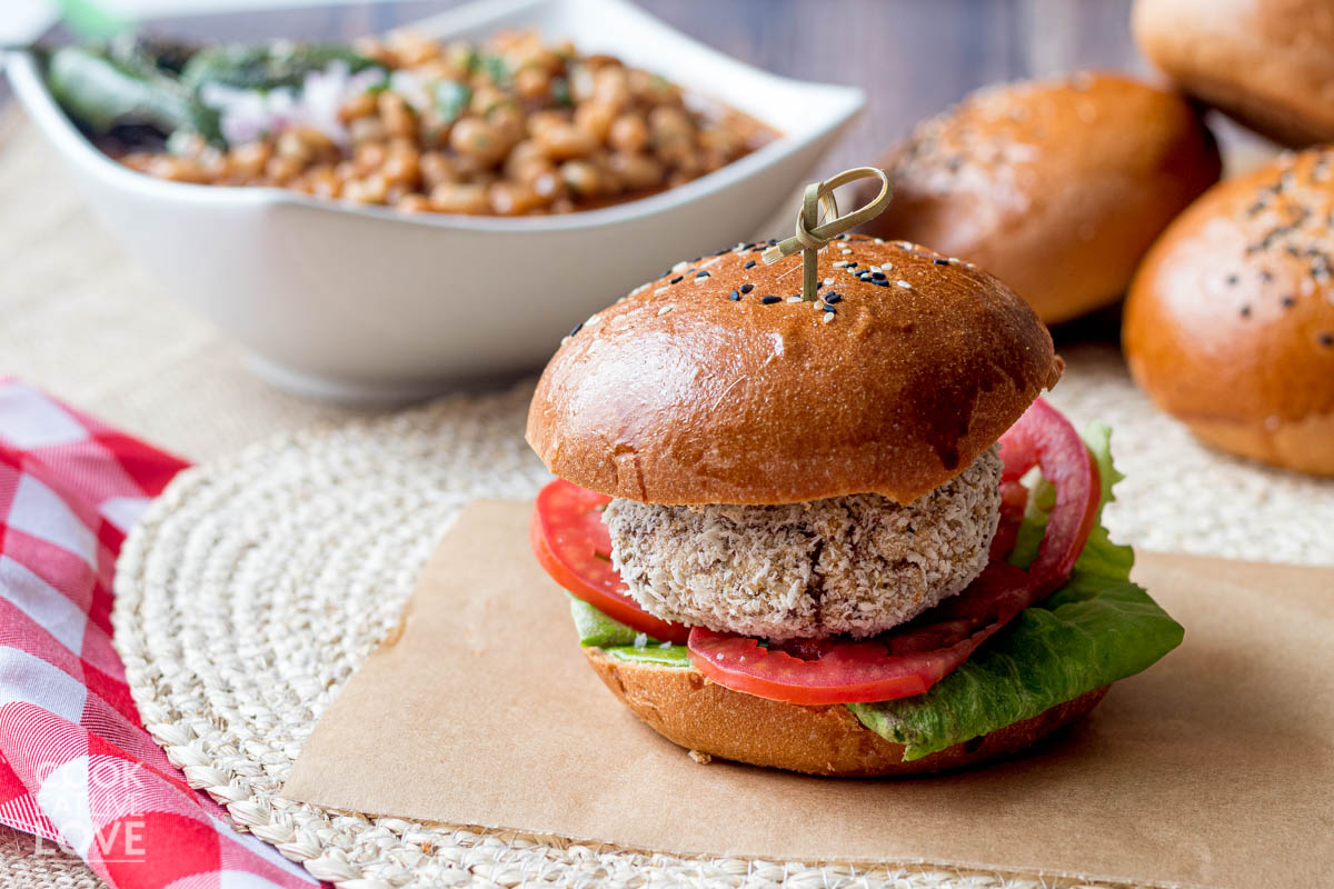 Crispy chickpea burger on a wheat bun with ketchup on side