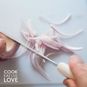 Close up of cut red onion feathers