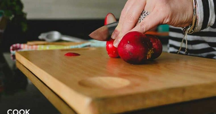 ,Showing knife, an essential cutting tool on wooden board cutting radishes.