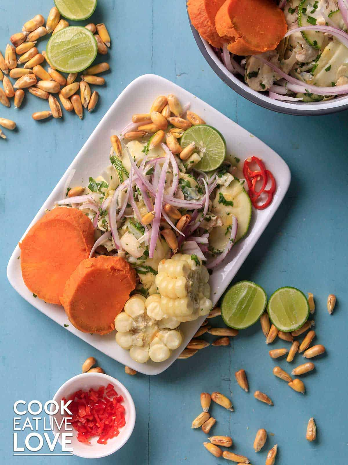 Vegan ceviche on a plate with sweet potatoes and corn