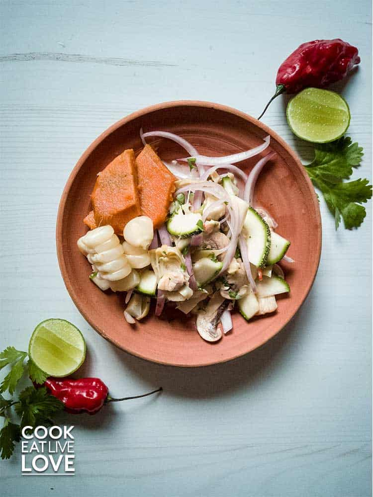 Plate of vegan ceviche is shown to demonstrate the appeal of the red onion feather cut.
