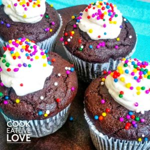 Delicious whole wheat chocolate cupcakes are frosted and ready to eat!
