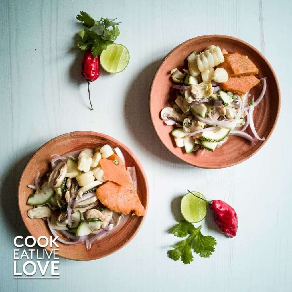Plates of ceviche on a table with limes, chilies and cilantro