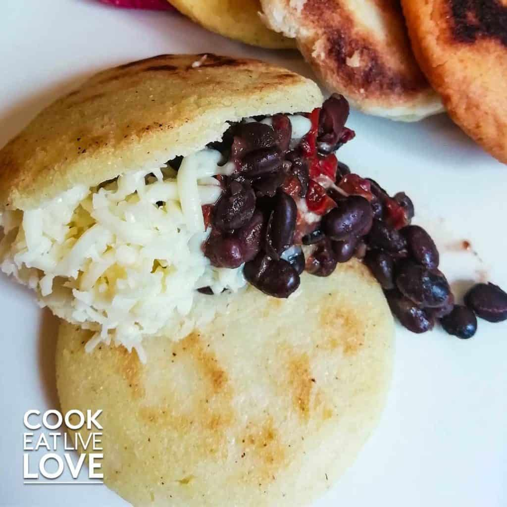 Arepas on a plate with beans and cheese