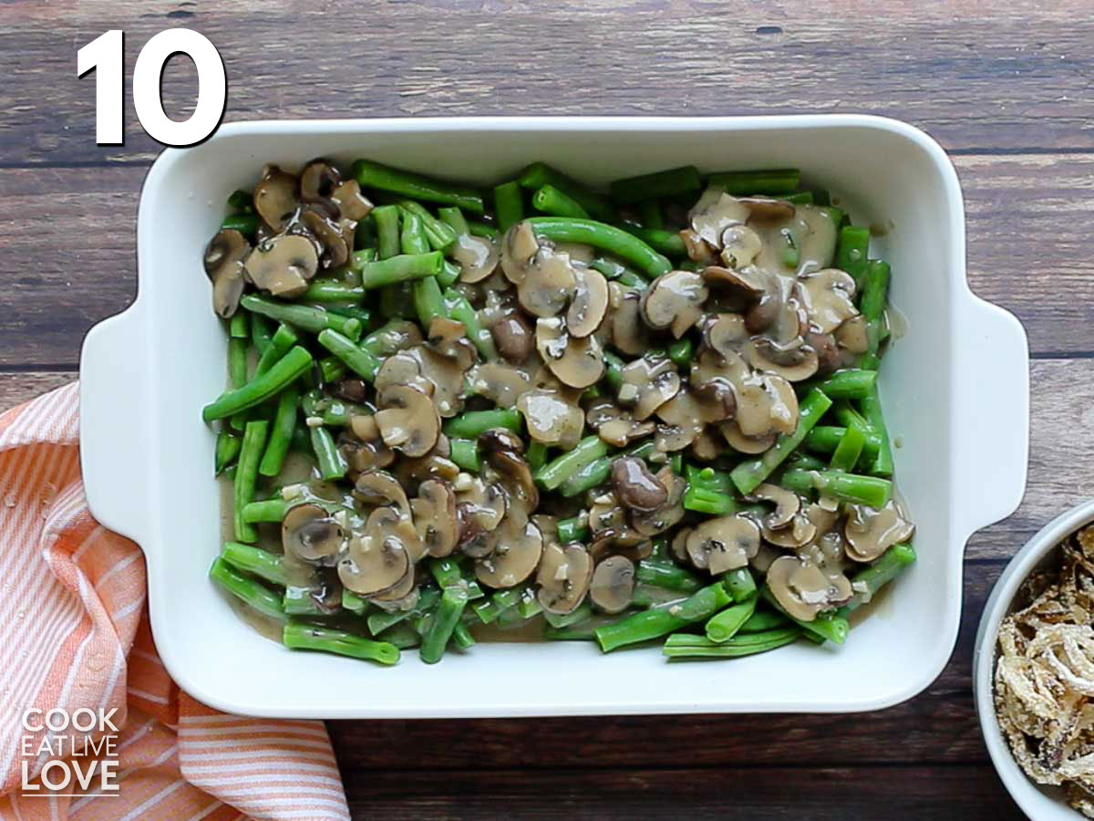 Green beans and sauce are layered into a casserole dish